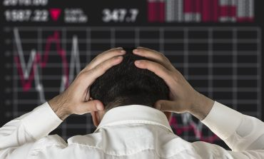 man sad by stock market crash