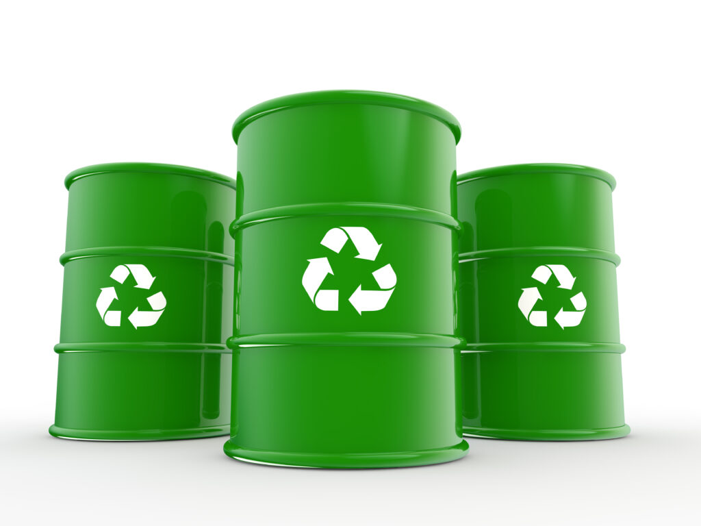 3d green drums with recycle symbol