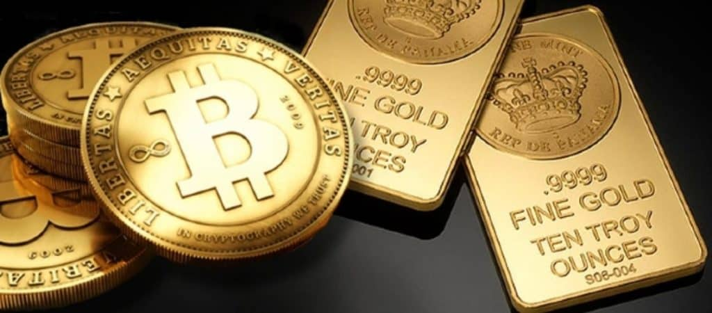 Gold bitcoin on top of gold bars