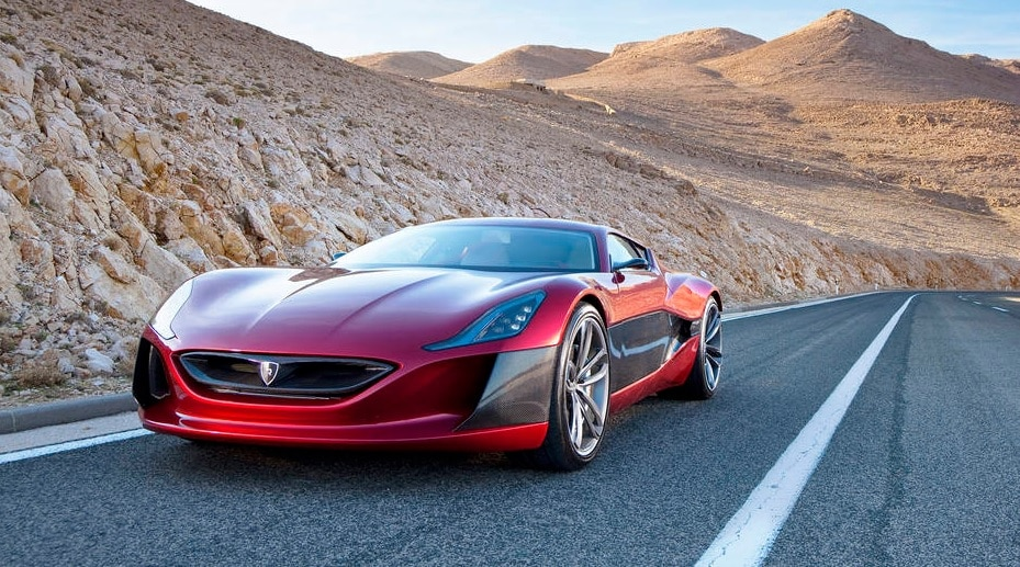 Red sports car on highway